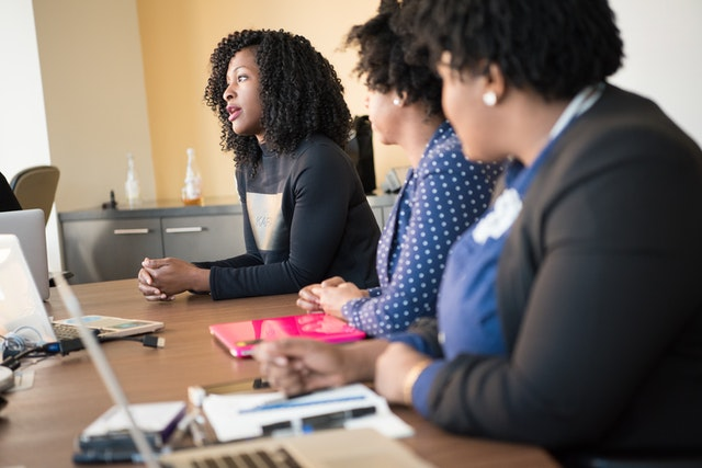 Black woman talking in meeting