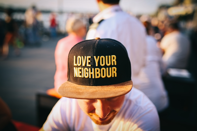 Man wearing Love Your Neighbor hat
